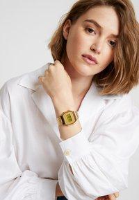 Casio - Digital watch - gold-coloured - 1