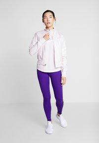 Nike Performance - MIDLAYER RUN - Sports shirt - barely rose/white - 1