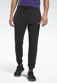 Reebok - SMALL LOGO ELEMENTS JOGGER PANTS - Tracksuit bottoms - black - 1