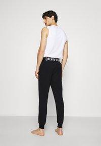 Calvin Klein Underwear - INTENSE POWER LOUNGE JOGGER - Pyžamový spodní díl - black/white - 2
