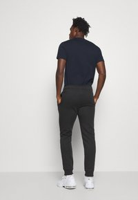 Champion - LEGACY CUFF PANTS - Tracksuit bottoms - black - 2