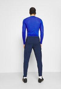 adidas Performance - TIRO 21 - Spodnie treningowe - team navy blue - 2