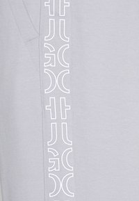 HUGO - DAKY - Tracksuit bottoms - silver - 5
