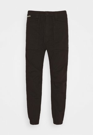 EKSTRO - Trousers - black