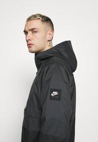 Nike Sportswear - AIR  - Waterproof jacket - black/dark smoke grey/white - 3