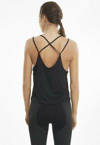Puma - STUDIO GRAPHENE  - Sportshirt - black - 1