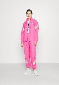 adidas Originals - SWAROVSKI TRACK  - Træningsjakker - solar pink - 1