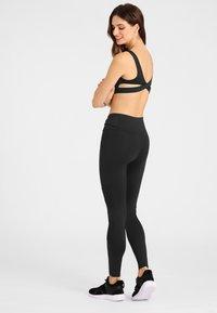 Daquïni - MOTO - Leggings - Trousers - black - 2