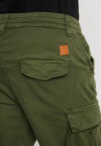Alpha Industries - AIRMAN - Cargo trousers - dark oliv - 4