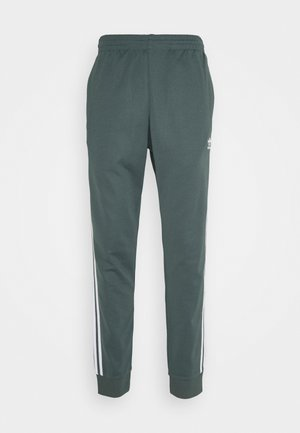 UNISEX - Tracksuit bottoms - blue oxide