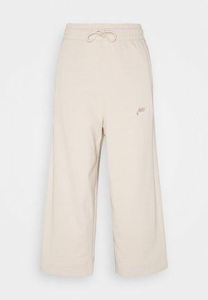 W NSW CAPRI JRSY - Pantalones deportivos - oatmeal