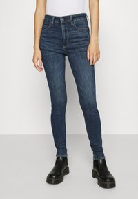 American Eagle - SUPER HIGH RISE - Slim fit jeans - night time navy - 0