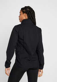 Nike Performance - Sports jacket - black/reflective silver - 2