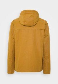 REVOLUTION - PADDED WINDBREAKER - Light jacket - brown - 1