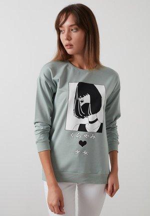 Sweater - almond green