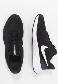 Nike Performance - REVOLUTION UNISEX - Neutral running shoes - black/white/anthracite - 0