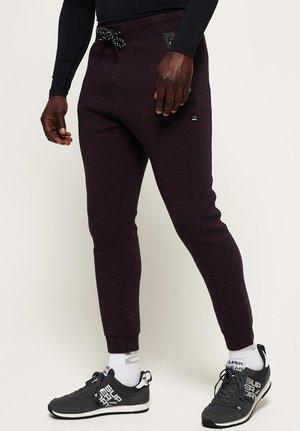 CORE GYM TECH - Pantalon de survêtement - purple