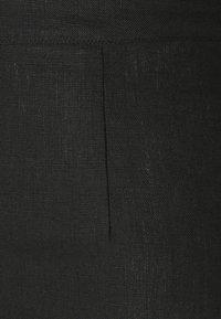 Faithfull the brand - SIBYL PANTS - Kalhoty - plain black - 2