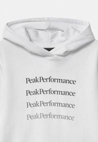 Peak Performance - GROUND HOOD UNISEX - Mikina skapucí - white - 2