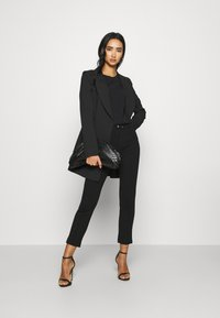 Diesel - P-CUPERY TROUSERS - Trousers - black - 1
