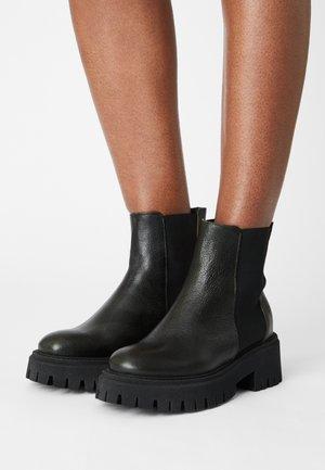 RUMIA - Platform ankle boots - baikal