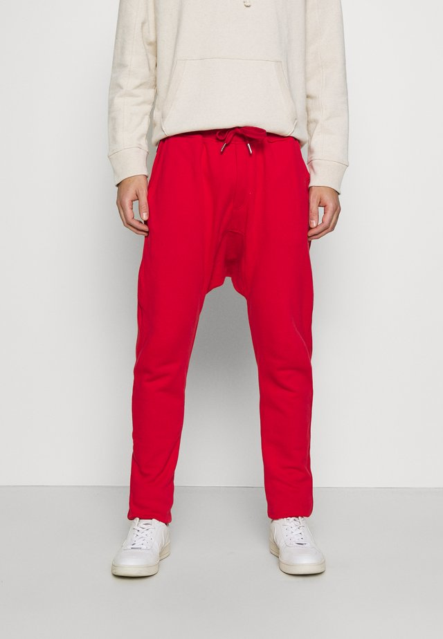 PAUL - Tracksuit bottoms - red
