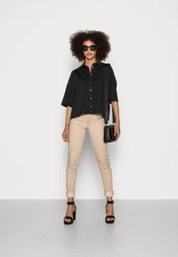 Marc O'Polo - JERSEY BLOUSE  SMALL STAND UP COLLAR BUTTON CLOSURE - Button-down blouse - dusty black - 1