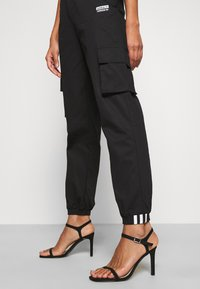 adidas Originals - PANT - Cargo trousers - black - 4