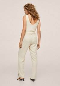 Mango - MED PRESS - Trousers - offwhite - 1