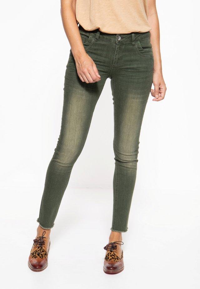 Slim fit jeans - olivgrün