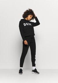 DKNY - EXPLODED LOGO HOODIE - Sweatshirt - black - 1