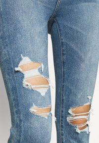 American Eagle - HIGHEST RISE CROP DREAM - Jeans Skinny Fit - blue street - 5