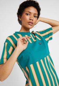 Puma - DOWNTOWN STRIPE DRESS - Sukienka letnia - teal green - 3