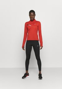 ASICS - WINDBLOCK TIGHT - Leggings - performance black
