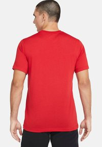 Nike Sportswear - T-shirt con stampa - university red