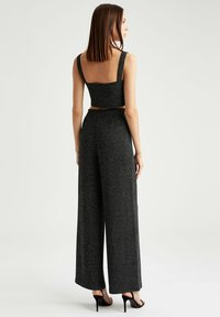 DeFacto - Trousers - black - 2