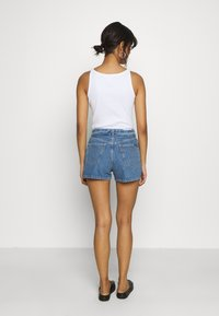Calvin Klein Jeans - HIGH RISE - Denim shorts - light blue - 2