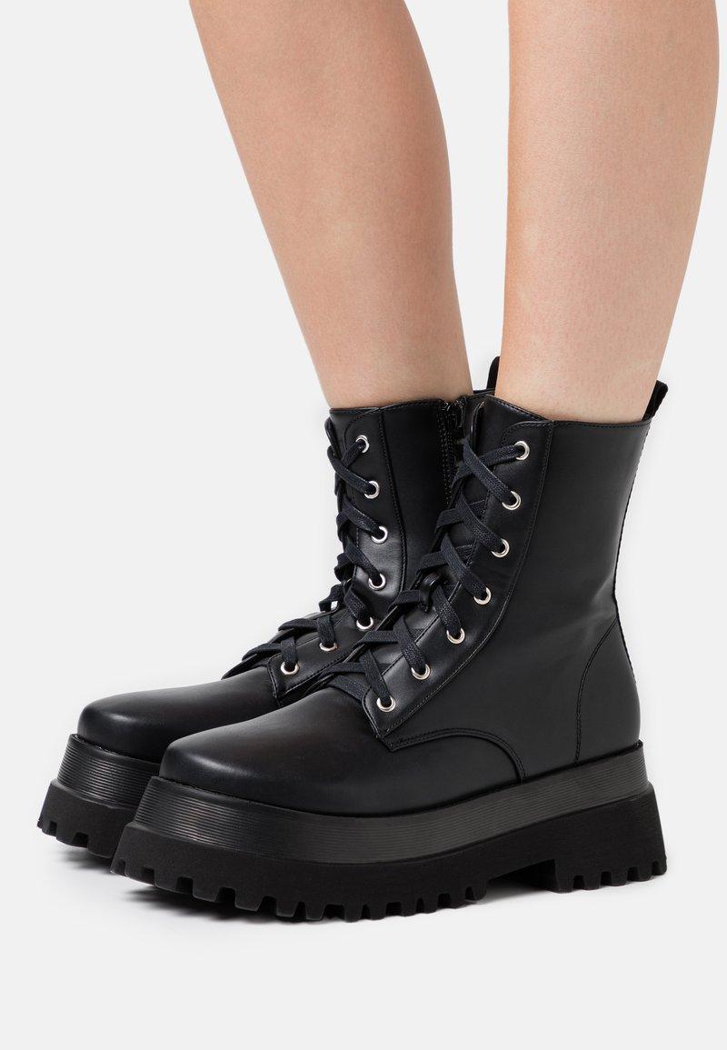 RAID - HARLOW - Platform ankle boots - black