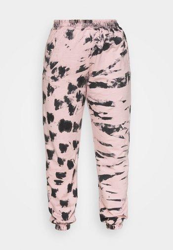 TIE DYE - Tracksuit bottoms - pink
