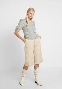 Gestuz - SURI - Leather trousers - safari - 1