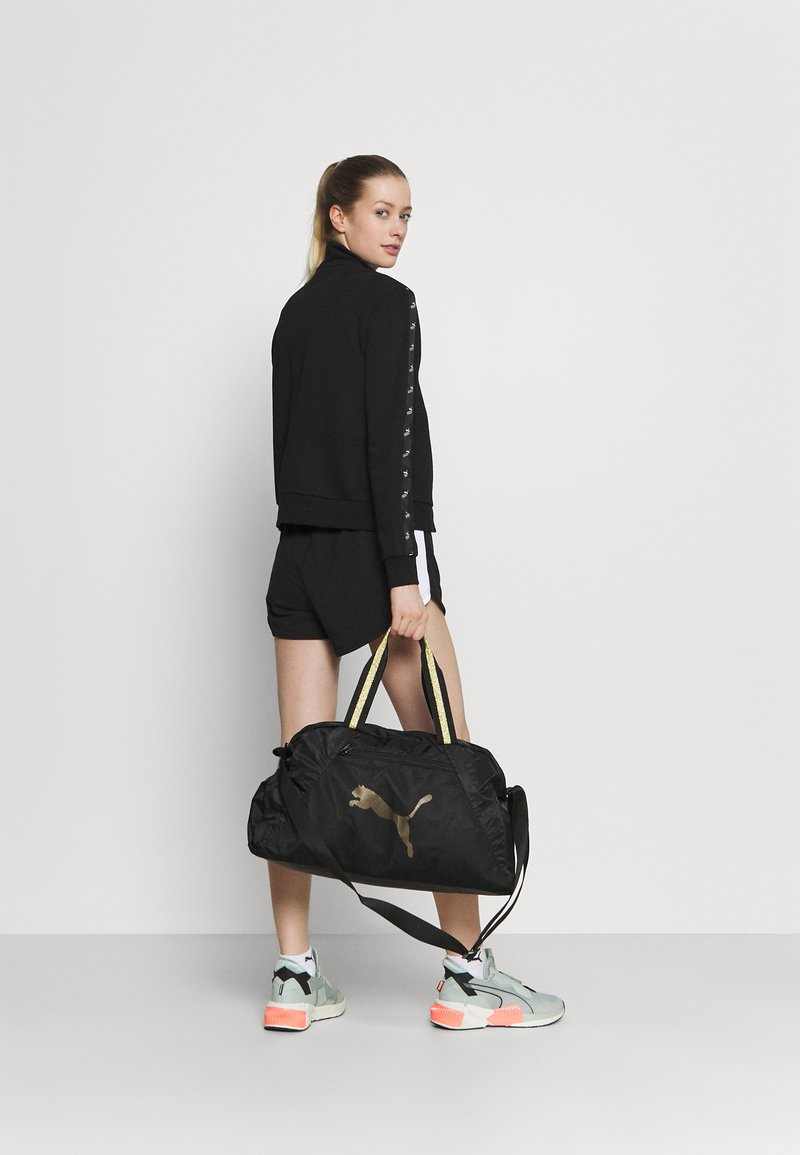 Puma - GRIP BAG 25 L - Sportovní taška - black/bright gold