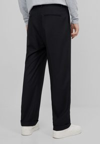Bershka - Trousers - black