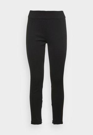 ELOTTI - Leggings - Trousers - black