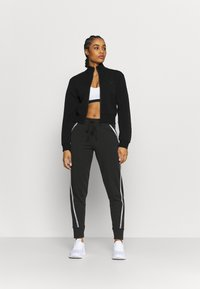 Under Armour - RIVAL TAPED PANT - Tracksuit bottoms - black - 1