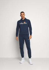 Ellesse - OSTERIA - Pantalon de survêtement - navy - 1