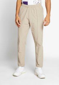Woodbird - HANSI TRACK PANT - Pantalon classique - sand - 0