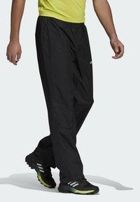 adidas Performance - TERREX MULTI RAIN.RDY PRIMEGREEN TWO-LAYER RAIN TRACK - Träningsbyxor - black - 4
