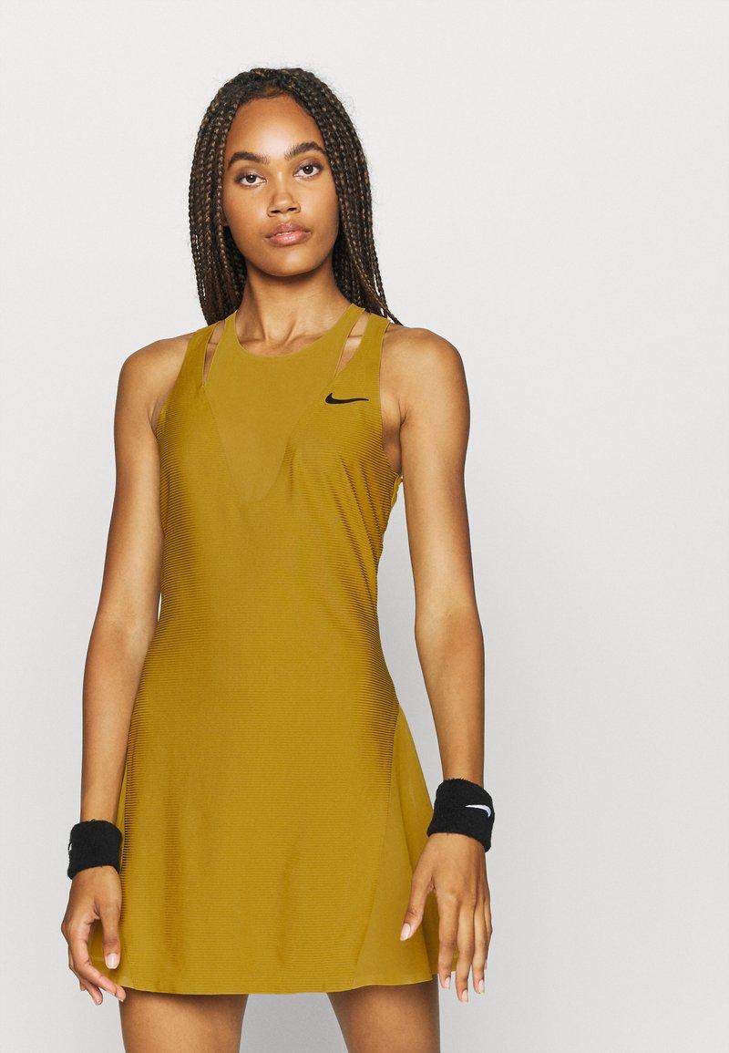 Nike Performance - MARIA DRESS - Sports dress - ochre/black