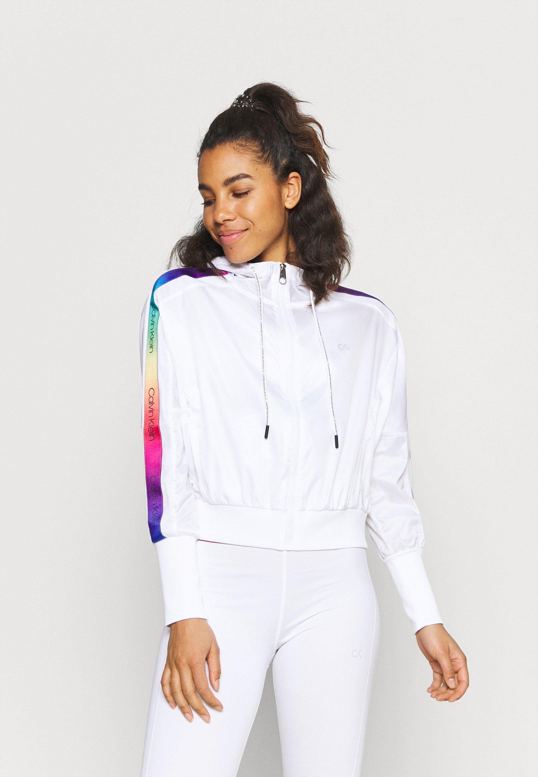 Women HOODED JACKET - Training jacket