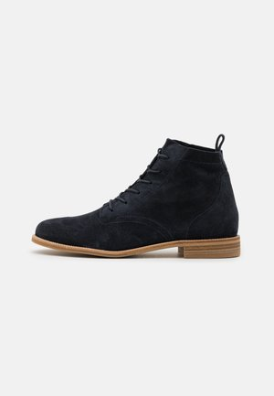 Lace-up ankle boots - space